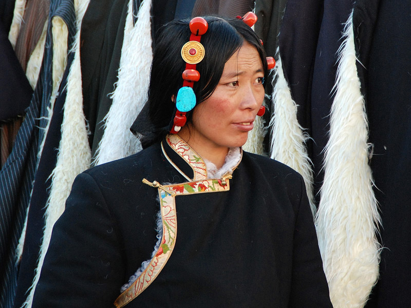 A Tibetan woman sells yak fleece overcoats in Lhasa. (Photo: Naomi Hellmann)