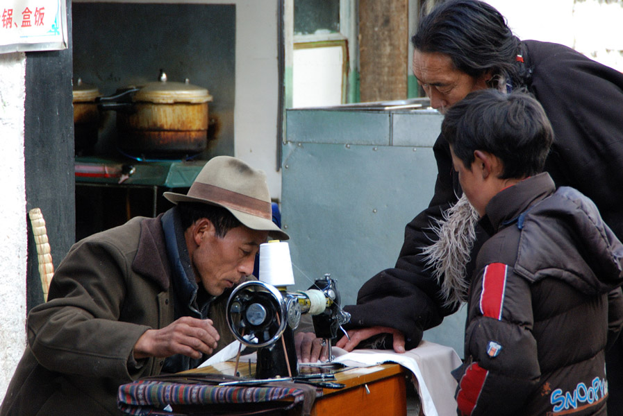 An outdoor tailor in Lhasa. (Photo: Naomi Hellmann)