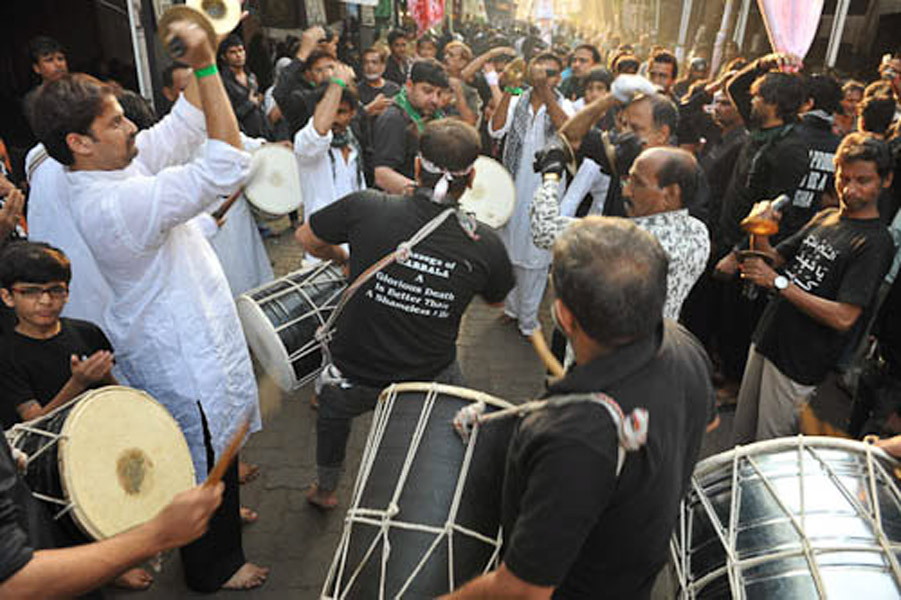 Playing Damam, Jail Rad, Dongri, Mumbai, December 2010 - Damam is a kind of drum from the south of Iran; it is still played by small Iranian diaspora community from the city of Bushehr, a port city in the south of Iran, during Muharram. (Photo: Reza Masoudi Nejad)