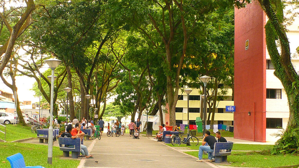 2pm along the public pathway in Boon Lay. The shade from the trees and a breeze make it comfortable for people to sit on the benches. (Photo: Junjia Ye)