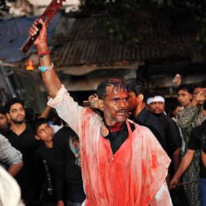 Flagellation: a flagellator in the procession of Ashura afternoon, Mumbai, December 2010 - Ashura is the 10th of Muharram, the first month of the Islamic-lunar calendar. The day is commemorated by Shia-Muslims as the day of martyrdom of the grand-son of Prophet Mohammad in a tragic battle in the 7th century. (Photo: Reza Masoudi Nejad)