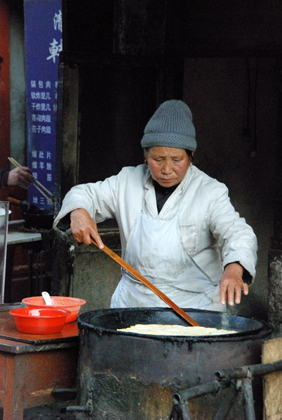 Making jianbing, a Chinese style egg and scallion pancake, in Harbin in northeastern China. (Photo: Naomi Hellmann)