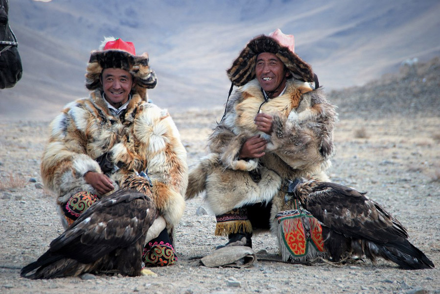 Kazakh eagle hunters relax at the Golden Eagle Festival in Bayan Ulgii, western Mongolia. (Photo: Naomi Hellmann)