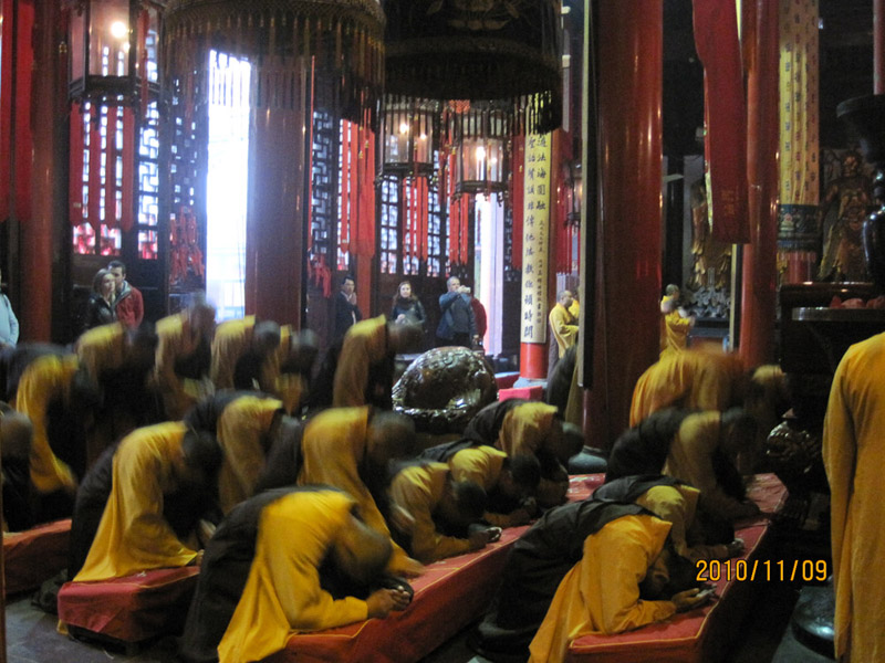 Tourists and religious practices. 2010, Shanghai. (Photo: Weishan Huang)