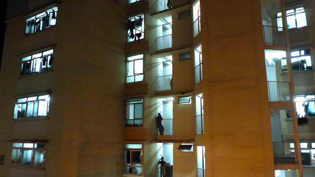 A typical week night at one of the migrant workers dormitory in Boon Lay. Migrant men share up rooms of up to 14 people per room. (Photo: Junjia Ye)