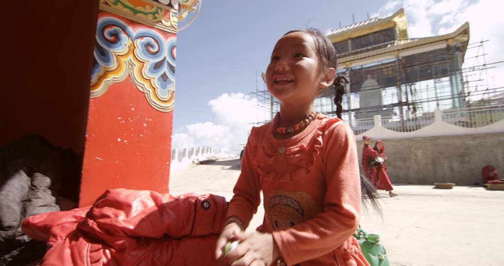 A young pilgrim in a Tibetan location. (Photo: Dan Smyer Yu)