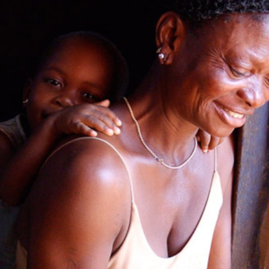 Ama Korkor with her grandchild. (Photo: Annelies Kusters)