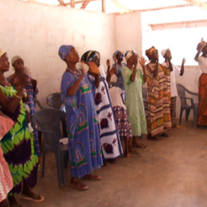 Deaf people signing a song during the church service. (Photo: Annelies Kusters)