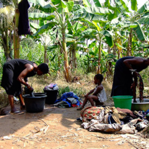 Deaf women washing clothes in the river. (Photo: Annelies Kusters)