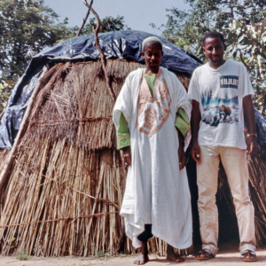 Fulani nomad and young urban Fulani in front of a moveable traditional hut (close to M'Bengué, Côte d'Ivoire). (Photo: Boris Nieswand)