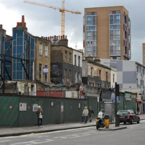 Gentrification: new building development next to derelict houses. (Photo: Doerte Engelkes)