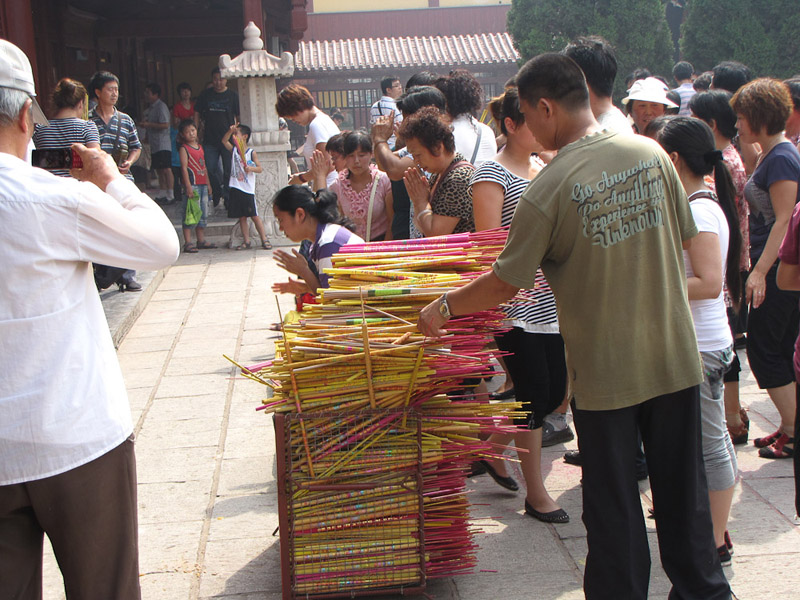 Prohibited from burning incense outside certain temple halls, devotees place their incense sticks in large containers.  At the Bailin Monastery in Hebei province, China. (Photo: Gareth Fisher)