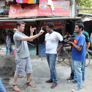 Jorn giving the cameramen feedback on the streets, explaining how to follow a protagonist with the camera. (Photo: Annelies Kusters)