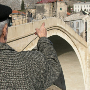 Old man from Mostar sharing his memories at the reconstructed Ottoman bridge, Mostar, Bosnia and Herzegovina. (Photo: Monika Palmberger)
