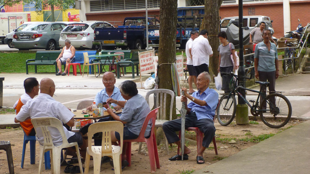 Senior men gather every day at this corner along a public pathway connecting the market, hawker center and public housing to gamble, chit-chat or to just to look. (Photo: Junjia Ye)