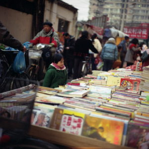 A young reader in an alley in Beijing. (Photo: Dan Smyer Yu)