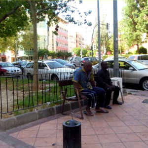 Chatting in the square II [Freeze-frame], Murcia, Spain. (Photo: Damian Omar Martinez)