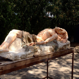 Symbolic displacement of longstanding Catholicism by Buddhism: Baroque 'Dead Christ Lying' in the backyard of a Buddhist socio-cultural association/Temple's new location, Murcia, Spain. (Photo: Damian Omar Martinez)