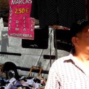Street market VI. Evangelist street preacher [Freeze-frame], Murcia, Spain. (Photo: Damian Omar Martinez)