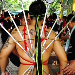 Singapore – Extreme body piercing by a spirit medium channelling the Underworld deity Di Ya Pek. (Photo: Fabian Graham)