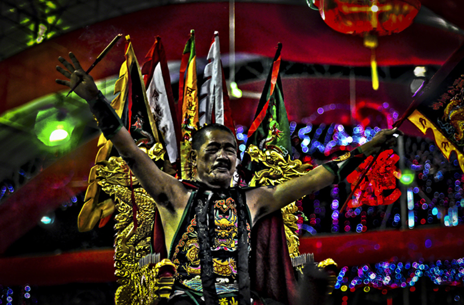 Singapore – Spirit medium channelling the warrior deity Fa Zhu Gong being carried in a sedan chair at the opening ceremony of the Ang Mo Kio United Temple. (Photo: Fabian Graham)