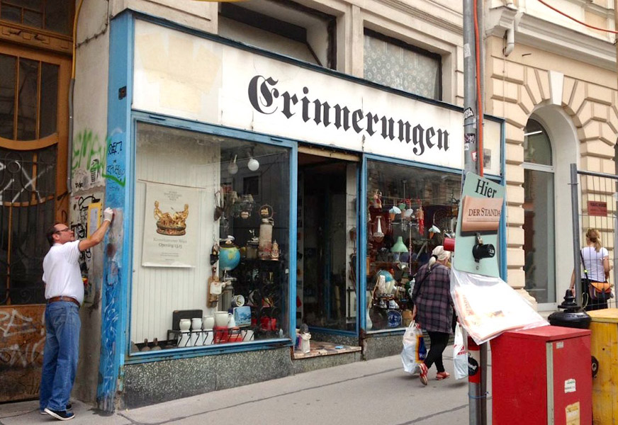 "Cultivating memories? A man cleaning the façade of the antique shop ""Erinnerungen"" ('Memories'). (Photo: Annika Kirbis)"