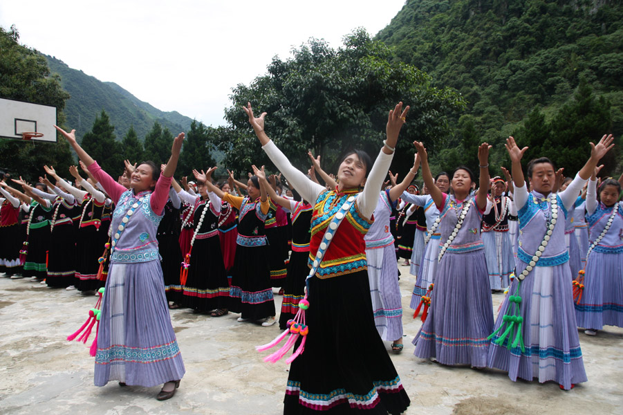 Attendees of Lumadeng Township Women Church Ministry Workshop rehearsing for the graduation performance, Fugong County, 8 July 2014. (Photo: Ying Diao)