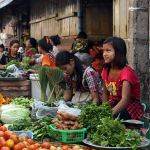Young women selling fresh vegetables. (Photo: Naomi Hellmann)