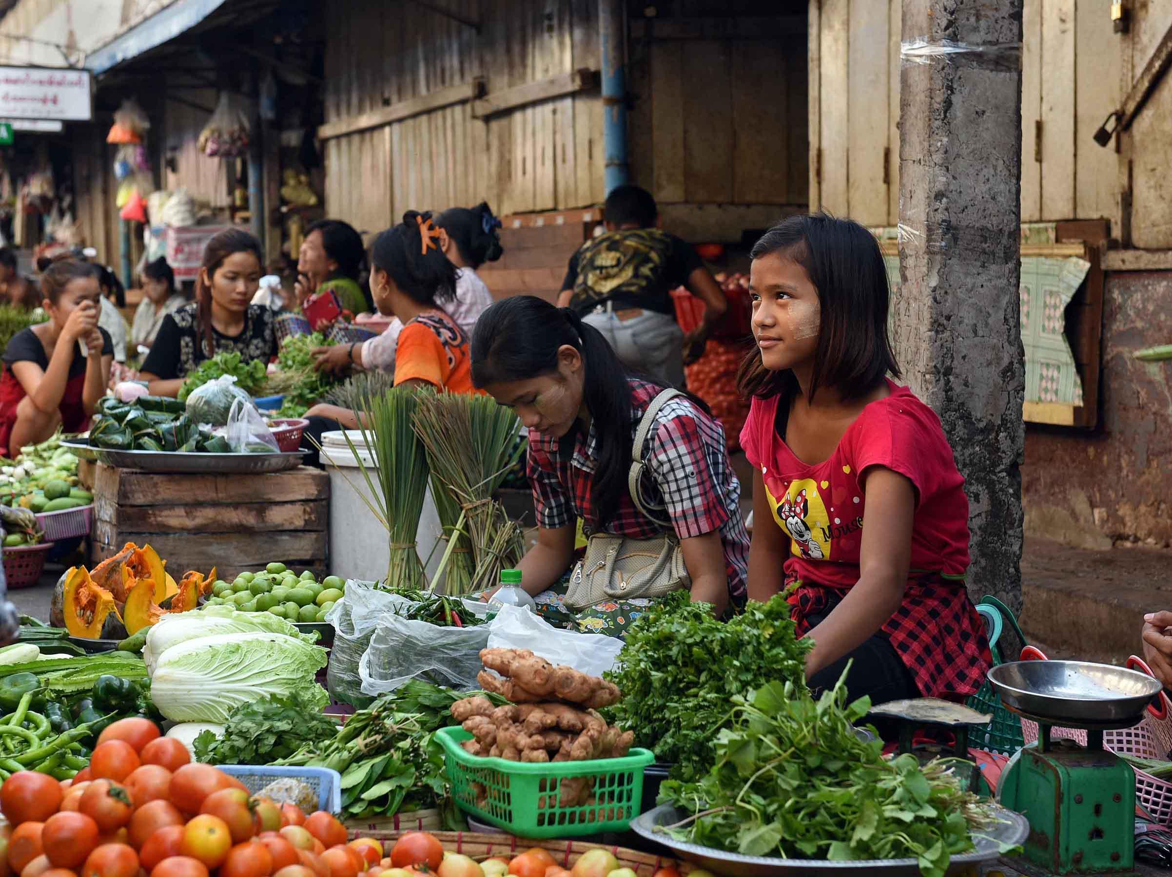 Young women selling fresh vegetables. (Photo: Naomi Hellmann)