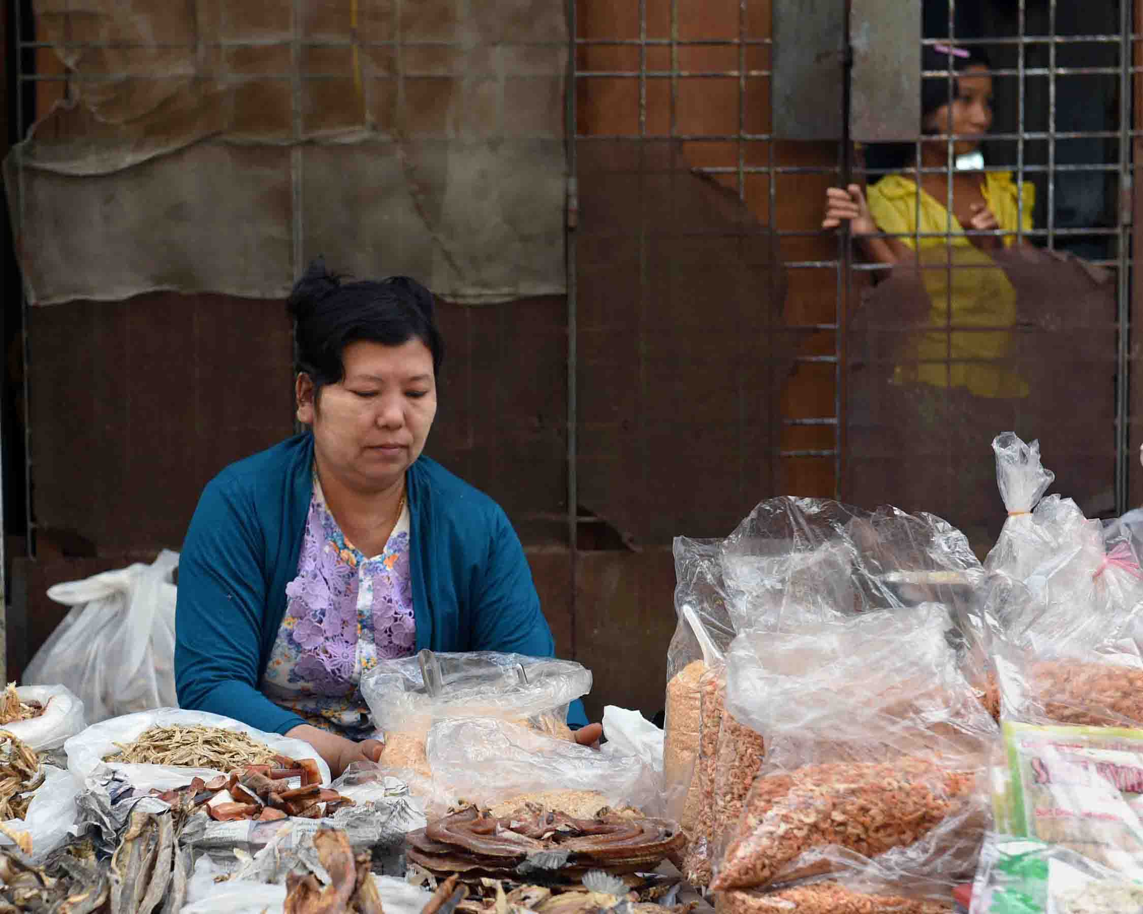 A woman selling assorted dried fish products. (Photo: Naomi Hellmann)