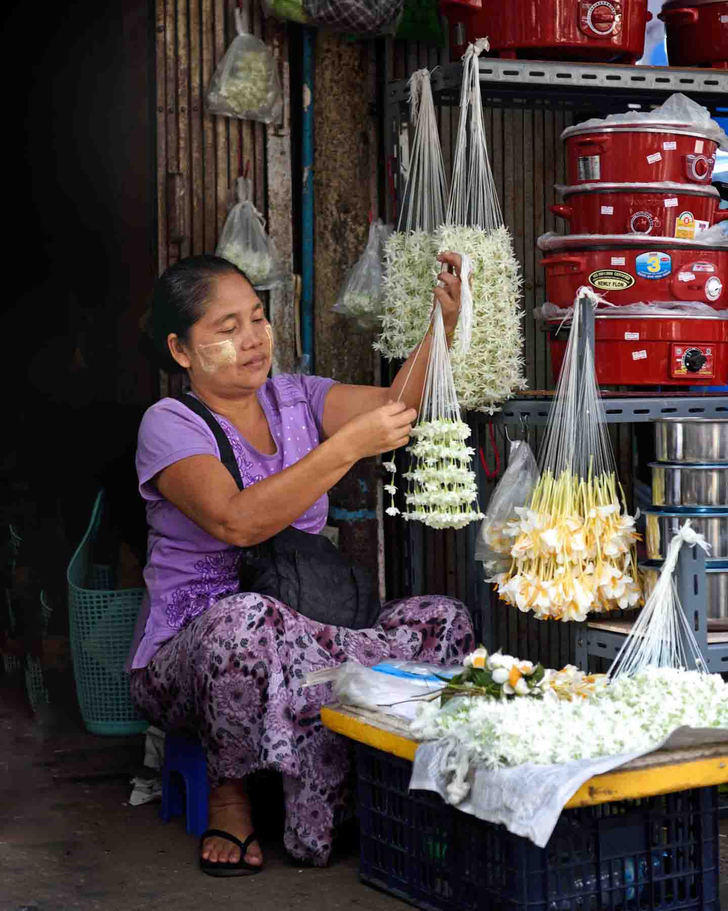Selling garlands of fresh Jasmine and June flowers, a fragrant, auspicious flower used like lei and as hair decorations as well as temple offerings for Buddhist deities. (Photo: Naomi Hellmann)