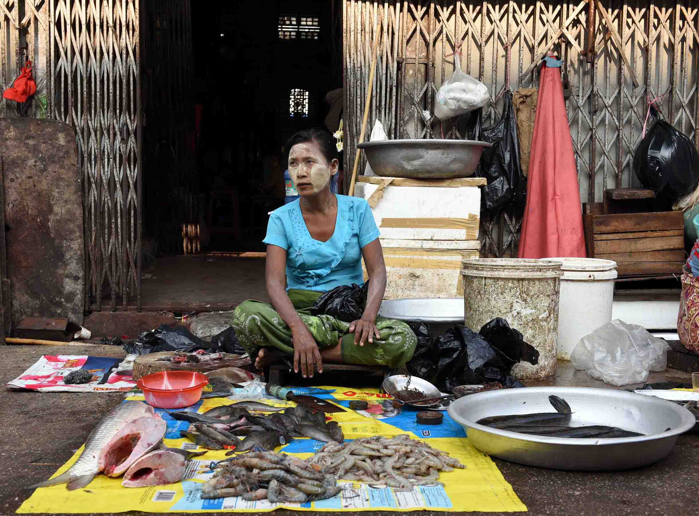 A fish monger waiting eagerly for customers. (Photo: Naomi Hellmann)