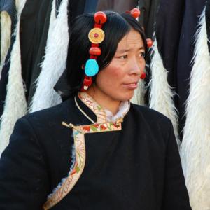 A Tibetan woman sells yak fleece overcoats in Lhasa. (Photo: Naomi Hellmann)