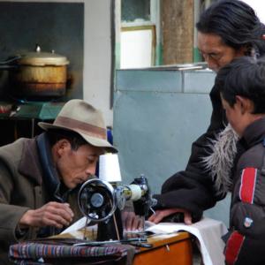 An outdoor tailor in Lhasa. (Photo: Naomi Hellmann)