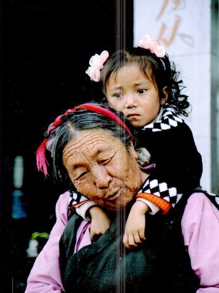 Resting on a stoop in Mangkang, Tibet. (Photo: Naomi Hellmann)