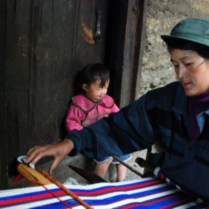 Blanket weaving in Qiunatong, Nujiang, Yunnan. Cotton string is purchased from a county market several hours away. (Photo: Naomi Hellmann)