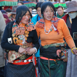 Tibetan women circle the Barkhor in Lhasa, Tibet, China. (Photo: Naomi Hellmann)
