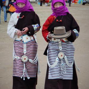 Tibetan women celebrate Naadam, an annual horse racing festival in Dangxiong, Tibet, China. (Photo: Naomi Hellmann)