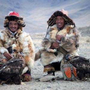 Kazakh eagle hunters relax at the Golden Eagle Festival in Bayan Ulgii, western Mongolia. (Photo: Naomi Hellmann)