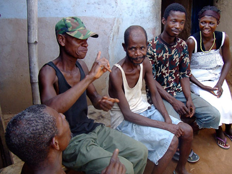 A group of deaf people chatting in a compound. (Photo: Annelies Kusters)