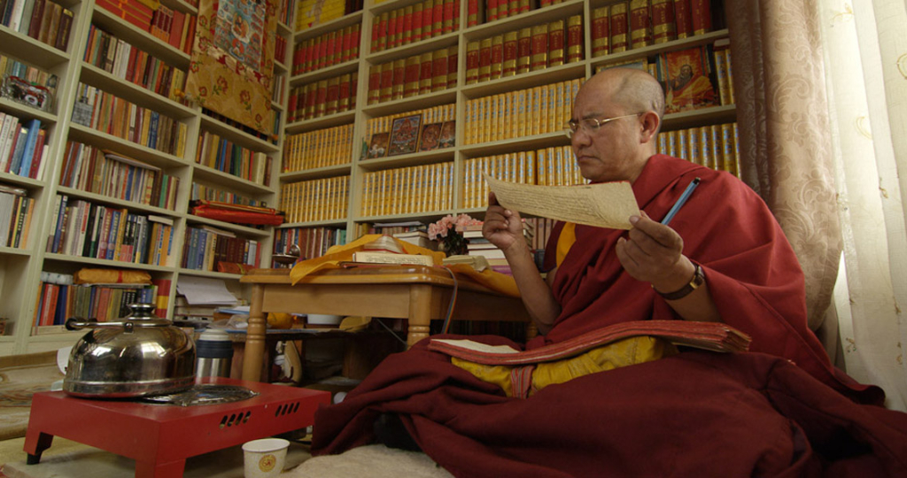Khenpo Sodargye reads a sutra in his study at Larung Gar Buddhist Academy, summer 2013. (Photo: Dan Smyer Yu)