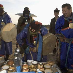 Members of the Local Shaman's Organization Tengeri preparing an altar during a tailgan ceremony. Verkhne Beriozovke, September 2005. (Photo: Justine Buck Quijada)