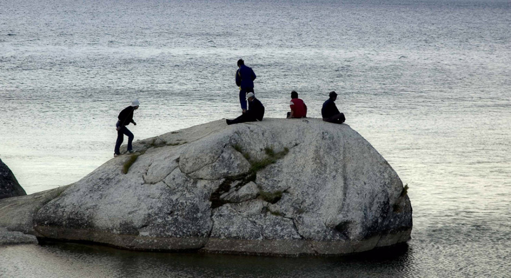 Members of the Shaman's Organization Tengeri on Shaman's Rock, Olkhon Island, Lake Baikal. July 2005. (Photo: Justine Buck Quijada)