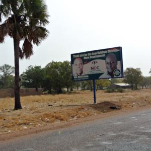 Campaign poster, Nabdam District, Ghana. (Photo: Elena Gadjanova)