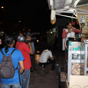 Prakash Khairnar shooting a woman ordering and eating pani puri, Annelies and Sujit observing. (Photo: Annelies Kusters)