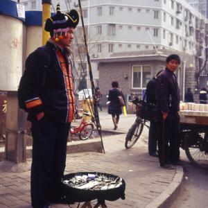 A Hmong jewelry vendor in Beijing. (Photo: Dan Smyer Yu)