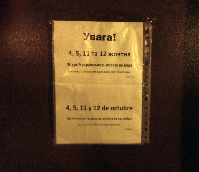"""Multi-lingual sign posted in a Catholic Church where Ukrainian Orthodoxs celebrate masses on Saturdays and Sundays afternoons: """"4, 5, 11 & 12 October mass in Ukrainian language are cancelled"""", Murcia, Spain. (Photo: Damian Omar Martinez)"""