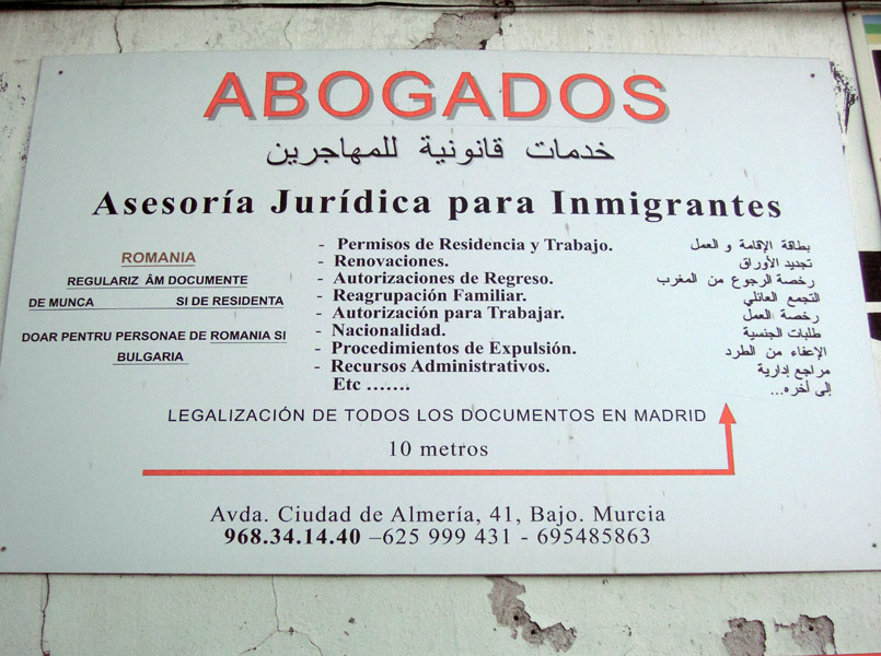Multi-lingual sign. Lawyers and legal advice for immigrants, Murcia, Spain. (Photo: Damian Omar Martinez)