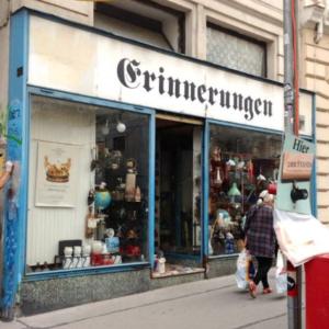"Cultivating memories? A man cleaning the façade of the antique shop ""Erinnerungen"" ('Memories'). (Photo: Annika Kirbis)"