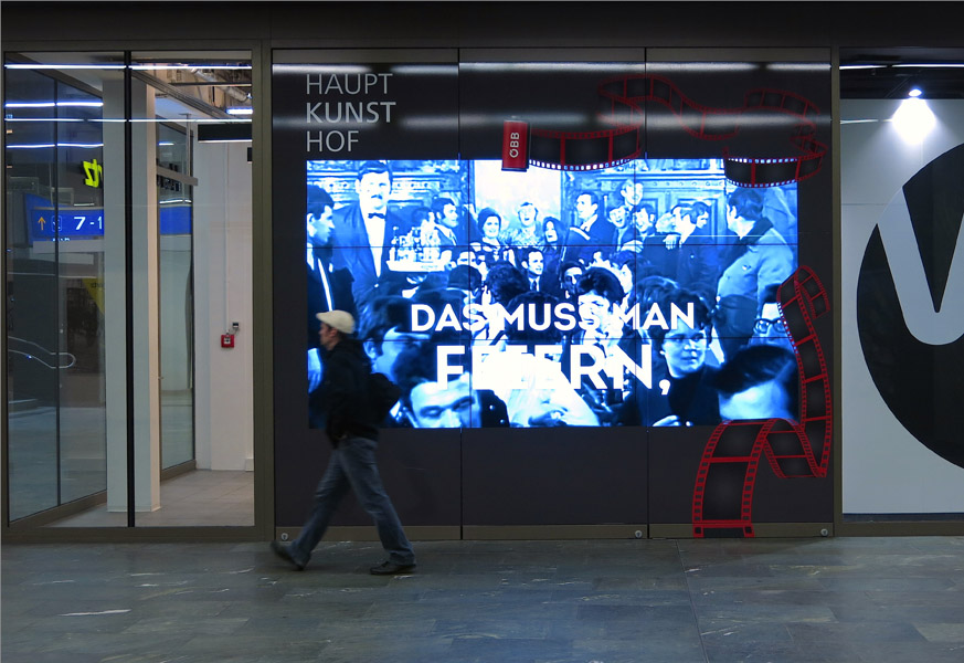 A video installation at Vienna main station complementing a conference on the 50th anniversary of the recruitment agreement between Austria and former Yugoslavia. (Photo: Annika Kirbis)